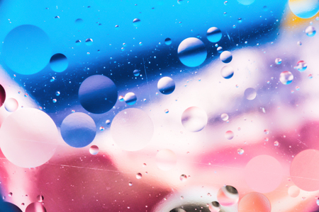 a grainy colored abstract background with scratches and stains consists of circles and balls in a rero style, blurred macro abstraction