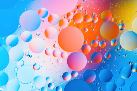 a combination of oil and water, a fantastic abstract macro background with blur elements and motion along the perimeter of the frame Stock Photo