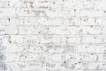 white texture painted old brick wall, damaged uneven brickwork, abstract background