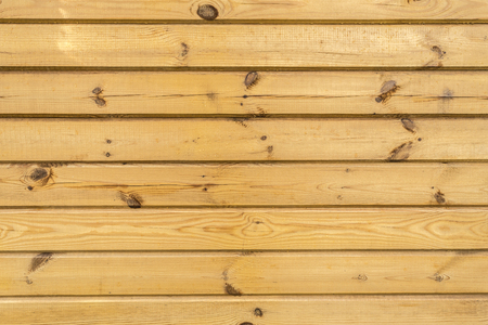 texture of horizontal wooden panels, wall of yellow boards with water drops, abstract background