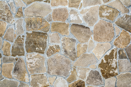 texture of an old antique stone wall closeup, architecture abstract background
