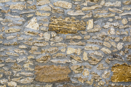 texture of an old antique wall from a porous limestone closeup, architecture abstract background