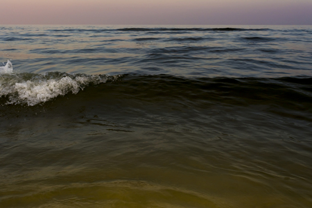 night sea with waves and foam, sea sky after sunset time, nature abstract background Stock Photo