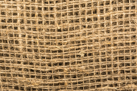 texture burlap, linen fabric with large jagged mesh, close up abstraction background