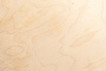 Real natural light birch plywood. High-detailed wood texture. Close-up abstract background