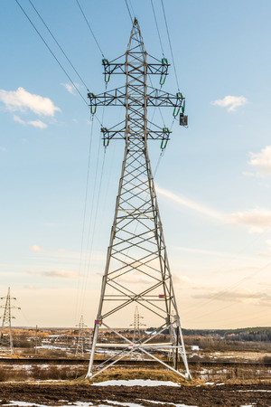 a high voltage power pylons against blue sky, power line