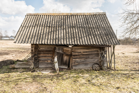 old damaged abandoned wooden building, broken country house of wooden logs, historical slavic architecture abstract background