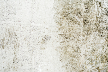 gray yellow texture of old antique wall, destroyed layer of concrete wall plaster, dark grunge abstract background