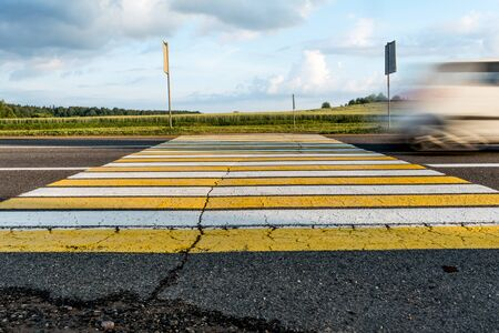 road marking pedestrian crossing on cracked asphalt, moving car through pedestrian crossing or zebra lines, abstract background Stock Photo