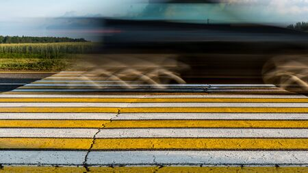 road marking pedestrian crossing on cracked asphalt, moving car through pedestrian crossing or zebra lines, abstract background Reklamní fotografie