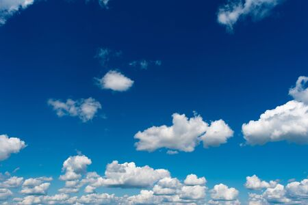 White, Fluffy Clouds In Blue Sky. Abstract Background From Clouds