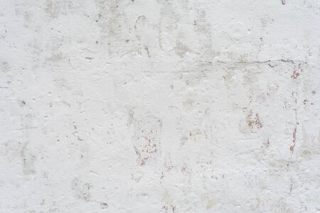 texture of a white wall with a damaged stucco layer, architecture abstract background 写真素材