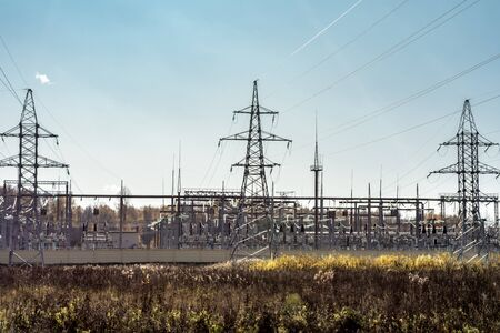 High voltage pole, High voltage power electric transformer substation, modern technology abstract background. Sunny autumn day with clear blue sky