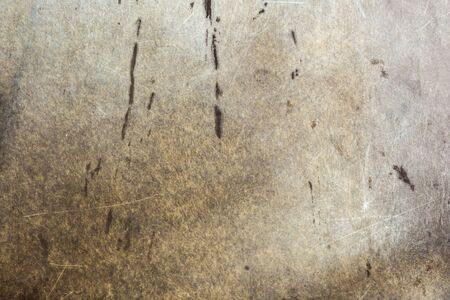 old texture of soiled scratched textolite or plastic, close-up abstract background