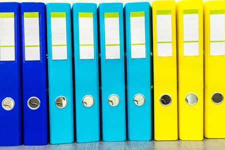 Large color folders for documents on the table in office, close-up, copy space 写真素材