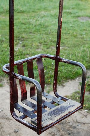 kinder: The old kinder swing on green background in the park