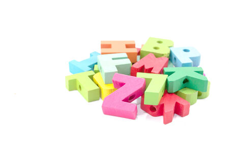 Colored card with letters of alphabet -multicolored plastic letters photo