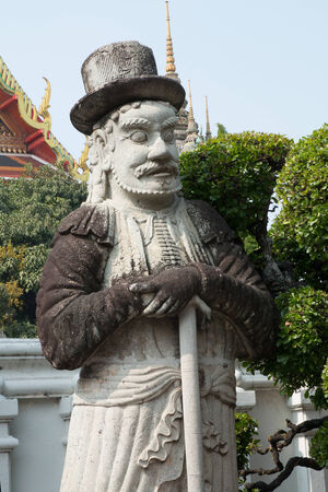 Old man statue in chinese style, Thailand  photo