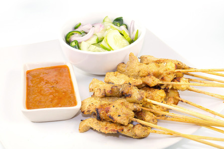 Grilled Pork Satay with Peanut Sauce and Vinegar on white
