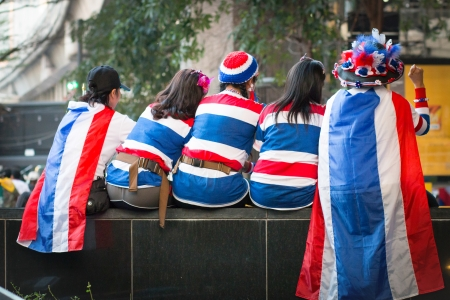 foreign policy: woman put dress color Thailand rally of the People