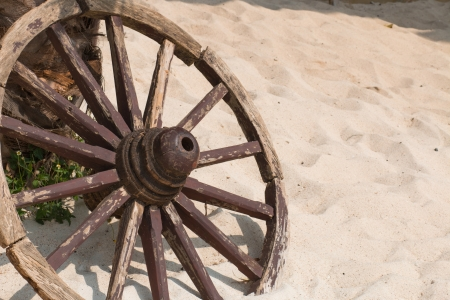 Old wooden wheel spokes photo