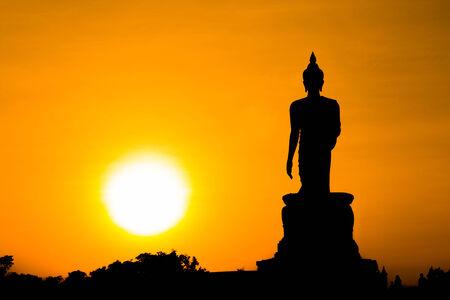 silhouette of Buddha statue sun photo