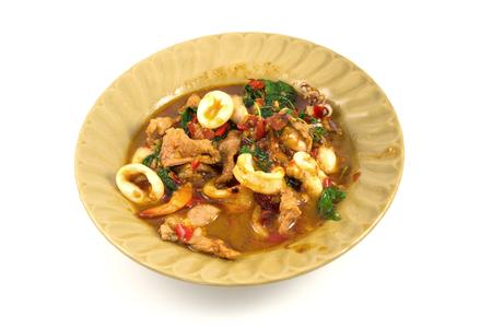 innards: Fried basil leave with pork, squid, shrim, innards, combination Stock Photo