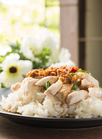 boned, sliced Hainan-style chicken with marinated rice photo