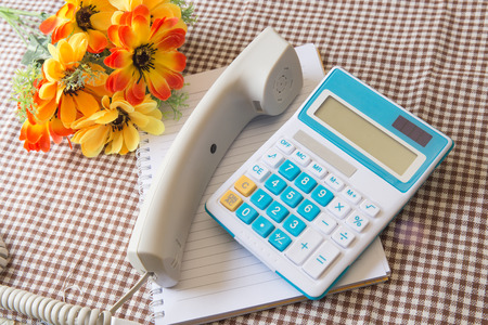 note paper: note paper, telephone, calculator and flower concept of office work