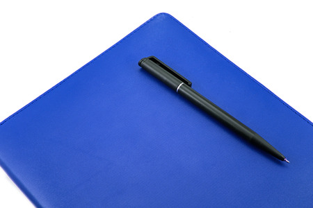 Leather notebook and pen isolated on the white photo