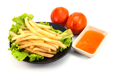 French fries with ketchup closeup over white Stock Photo - 31769411