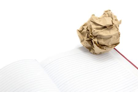 scrunch: Crumpled paper ball and book