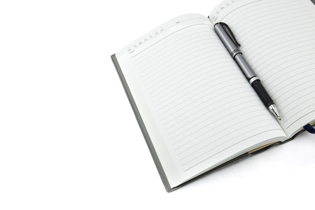Business diary with a pen on wood table Stock Photo