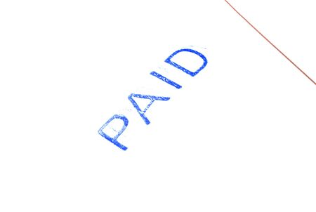 paid: Macro of Paid stamp on invoice