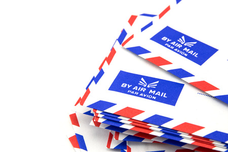oversea: Air mail letter stack on white background.