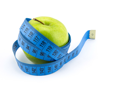 measured: green apples measured the meter, sports apples, concept weight loss