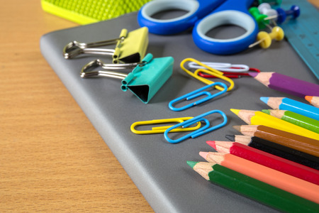 crayon  scissors: School stationery on wood table
