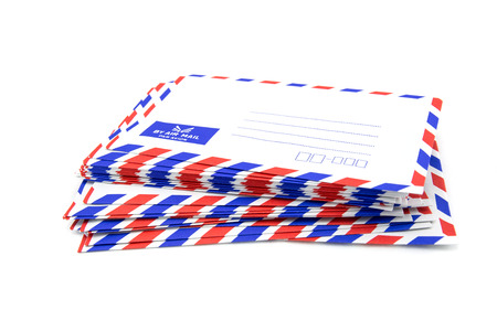 air mail: Air mail letter stack on white background.