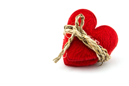 in bondage: Red heart with a bundle, concept with love with bondage on a white background