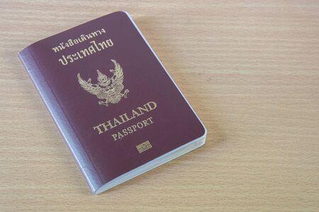 holidays vacancy: thailand passport on wood table