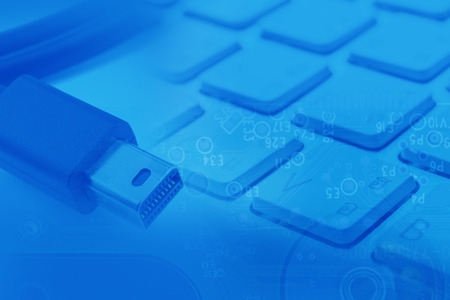 transfering: Thunderbolt Cable and keyboard abstract digital background Stock Photo
