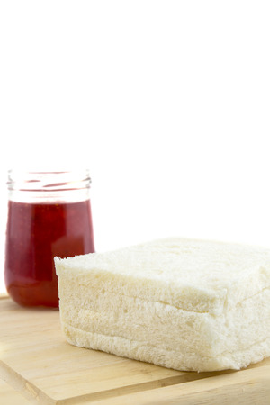 A bottle of strawberry jam and brea Stock Photo