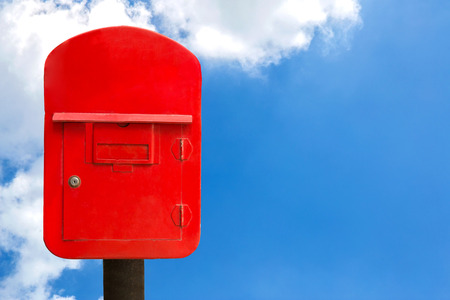 red post box: Red post box and sky, clipping path Stock Photo