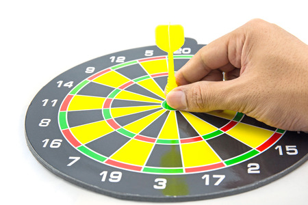 setting goal: Setting goal or accurate planning, hand going to take dart into the center of dartboard