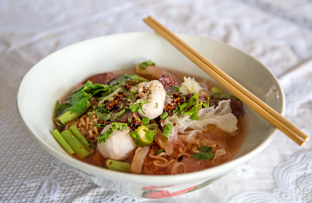 seafood soup: Noodles with seafood soup and red sauce