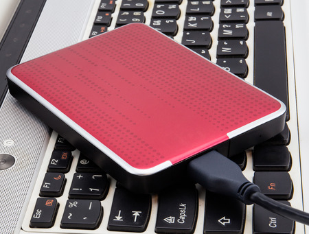External HDD over notebook keyboard 写真素材