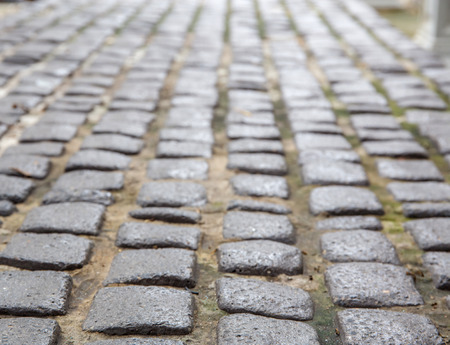 cobbled: cobbled road as background soft focus Stock Photo