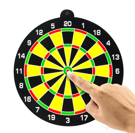 setting goal: Setting goal or accurate planning, finger going to take dart of target Stock Photo