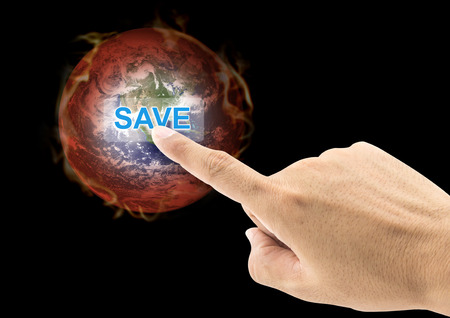 nasa: Safe world concept . finger press the button hot world ball on black background.Copy Space on horizontal sheet. Earth image provided by Nasa.