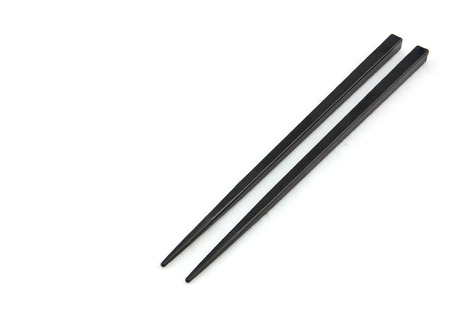 pairs: Wooden pairs of chopsticks on white background